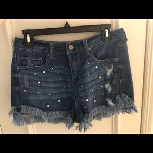 High waisted jean shorts with pearls and studs.